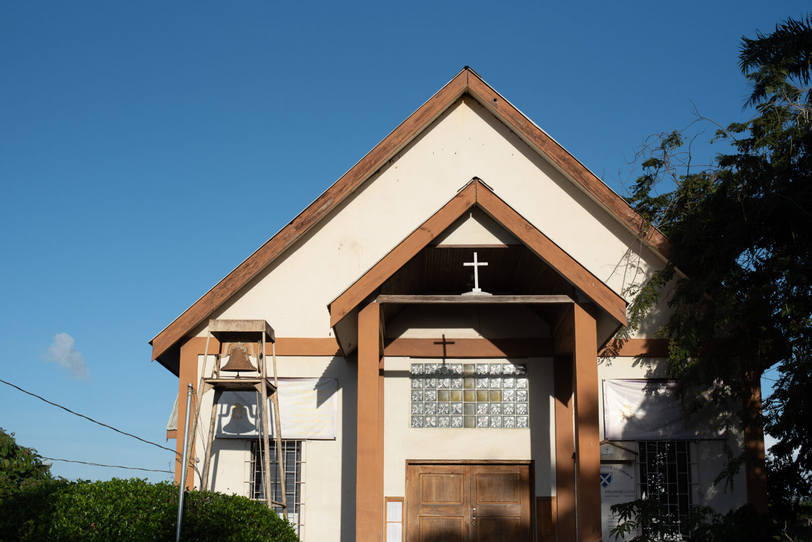 small church building with a cross over the front entrance