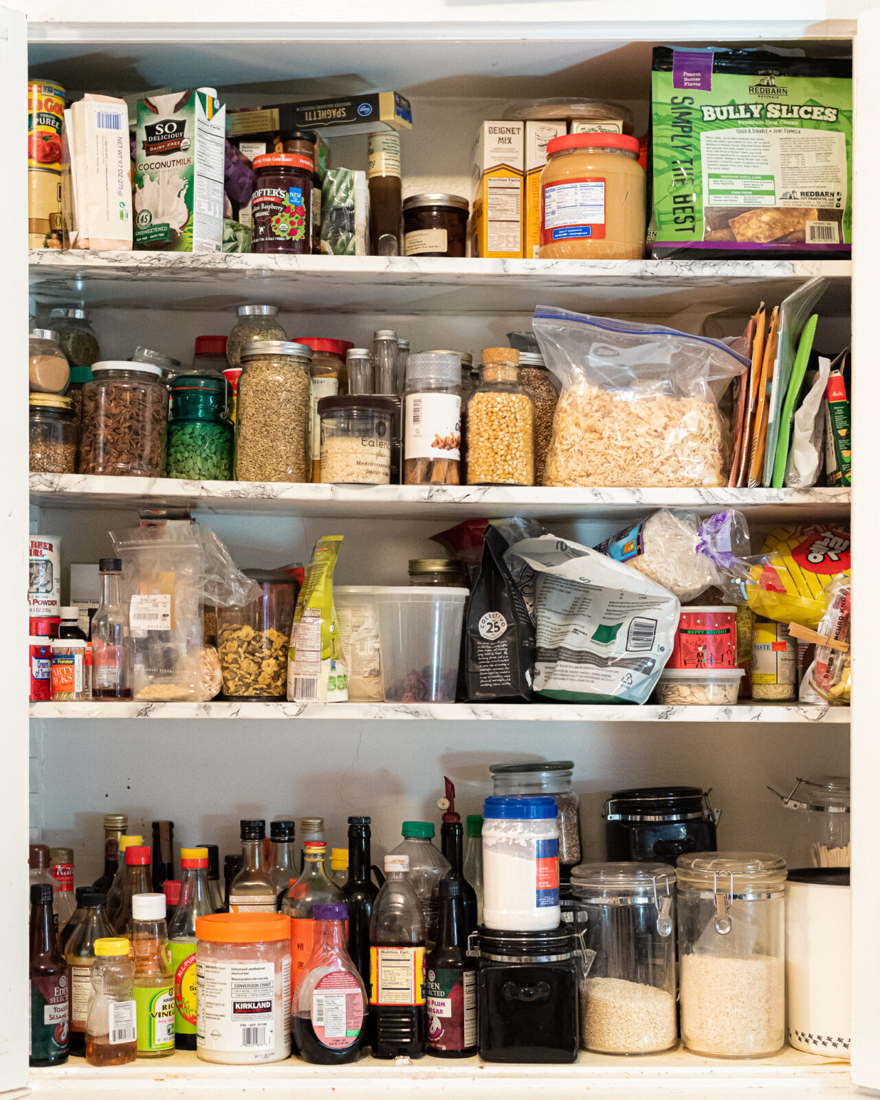 four level shelves with assortment of kitchen pantry items
