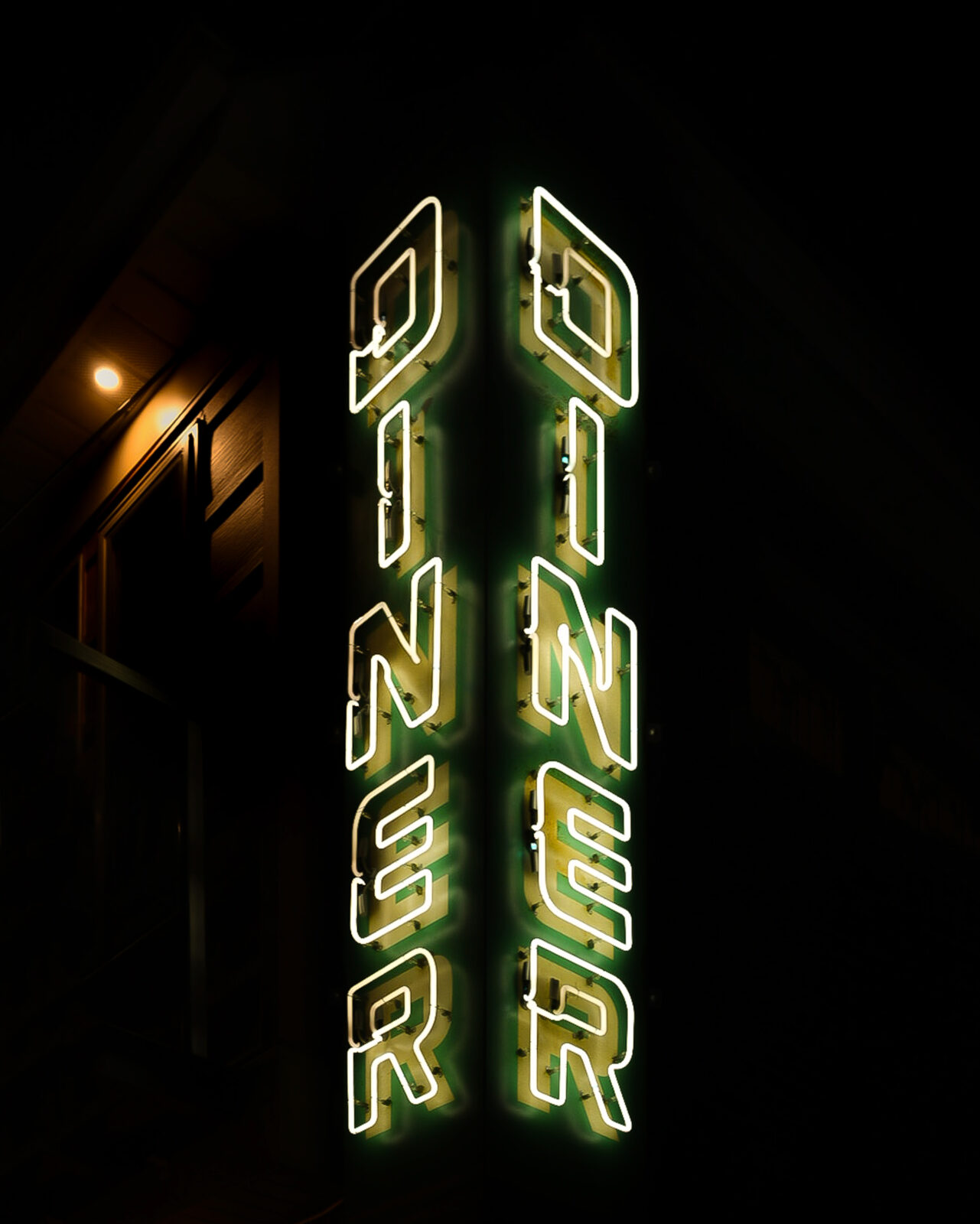 corner neon sign with the word