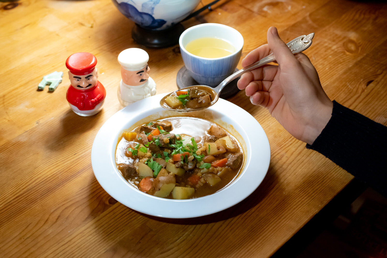 a pasta bowl with beef stew, including potatoes, carrots, beef, and parsley